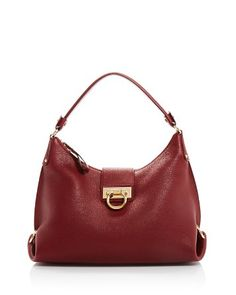 With rich pebbled leather construction, signature gold-tone hardware and a softly structured silhouette, this Salvatore Ferragamo hobo packs a lot of luxe details into one petite package. Hobo Packs, Leather Hobo Handbags, Signature Logo, Shoulder Strap, Shoulder Bags, Red Gold, Pebbled Leather, Salvatore Ferragamo, Opera