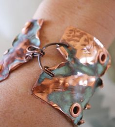 Art Jewelry Elements: April 2012. Interesting way to close a cuff.