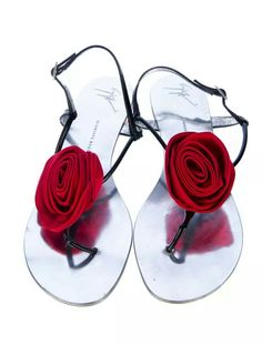 23bfd674765d19 Giuseppe Zanotti patent sandals with eye popping red rosettes.