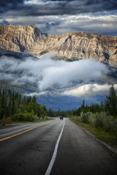 This early morning scene, the low hanging cloud, the early light bringing up the detail of the mountain range, was the start of one of the most spectacular drives anywhere, through Jasper National Park on the Icefield Parkway.