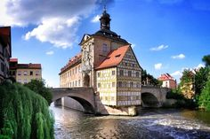 Bamberg, Germany. If Munich and Venice had a baby, it would be Bamberg. The German style architecture, with buildings built over or adjacent to water.
