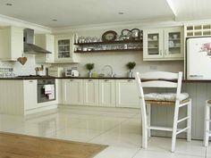 White cabinets, white furniture, dark counters, white tile floor