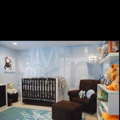 Very cool looking nursery. Love the shades of brown and blue.