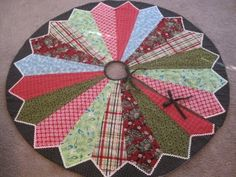 Triple Dresden Tree Skirt Maybe All Red With Big Triangular Green Leaves In Back