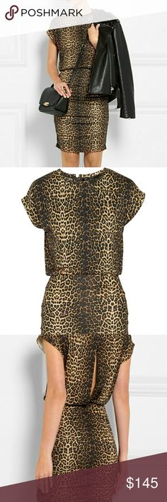 Maje Katanga mini dress Soft stretch jersey holds the bodycon shape of this animal print mini, while letting you move around with ease. An open slit back lets you show off just a hint of skin. Sexy and classy! Maje Dresses