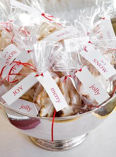 A silver bowl is filled with cookies as favors for party guests.