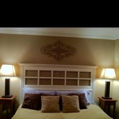 A recycled French Door, add some crown moulding and trim, and wah-lah! A beautiful headboard!