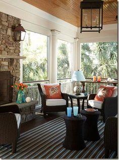 orange pillows, fireplace