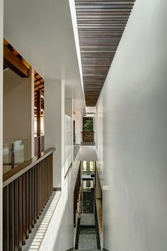. A straight flight staircase emerges from a strip water body on the ground floor and opens into the first floor passage.
