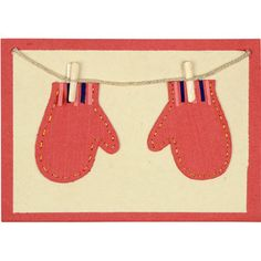 """Say goodbye to soggy mittens with this adorable holiday card made in Bangladesh. Each card is adorned with a pair of stitched mittens held by a piece of real string and tiny wooden clothesline clips. Our partner, Prokritee (meaning """"nature"""" in Bengali), provides jobs for poor rural women: widows and divorcees, primarily rural, landless and with little or no income. This card for the person on your list who wants to make a difference."""
