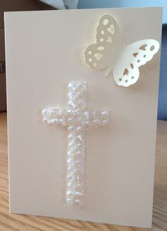 Christening card ... Pinning for the concept of making a cross out of pearls or other embellishments.