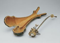 """Tobacco pipe in its original case on display in Gallery 533, European Sculpture and Decorative Arts, Metropolitan Museum of Art, New York City.    """"Date: ca. 1740 Culture: South German Medium: Silver, deer antler, horn, leather Dimensions: L. of pipe: 15-1/4 in. (39.2 cm.); L. of case: 16-1/3 in. (41.2 cm.), W. 3-1/2 in. (8.5 cm.) Classification: Metalwork-Silver In Combination . 1600-1800."""""""