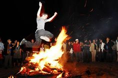 Man jumping over a bonfire in Iran. This is an ancient Zoroastrian traditional festival. On the last Tuesday of the Persian New Year, people jump over bonfires. Symbolically, the fire would take the pallor, sickness, and problems and in turn would give warmth and energy. The efforts by the Iranian regime to eliminate such festivities have resulted in more intense celebrations and a day of significant confrontation with the regime.