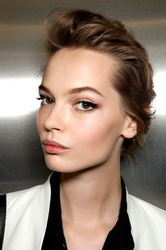"DIY: Follow McGrath's perfect-skin protocol: a layer of moisturizer, then allover foundation. Next, a concealer to camouflage blemishes, followed with ""highlighter on the brow bone, a little bit on the cheekbones, and white eyeliner on the inside corner of eyes,"" McGrath says. Finish with mattifying powder on the T-zone.  Pair with POWER LASHEs"