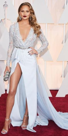 Academy Awards 2015 Red Carpet Arrivals - Chrissy Teigen in a Zuhair Murad gown with an Oroton clutch. from #InStyle