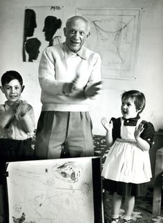 """""""Picasso and his children celebrating the completion of a collaborative drawing, 1953."""""""
