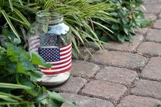 Check out this awesome #DIY project. Line your outdoor space with American flag jars filled with tea lights.