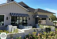 """Give your patio an """"outdoor café"""" look with Sunbrella fabric awnings custom made by Phoenix Tent and Awning Company. #outdoorliving #windowawning #patioawning"""