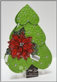 Christmas tree card ... made from die cut hearts embossed with poinsettia embossing plate ... large stamped poinsettia too ... like the creativity of this card ...