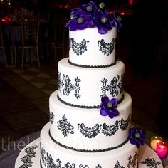 Sugar anemones and damask details decorated the four-tiered cake covered with fondant.