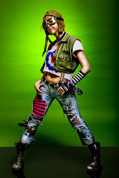 I love everything about this. The short jacket, suspenders, casual ripped jeans with striped leggings and of course the helmet and goggles. Excellant.