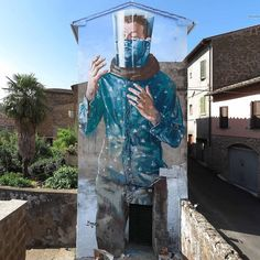 """New mural from Fintan Magee @fintan_magee - 'Drowning While Standing' in Acquapendente, Italy for @urbanvisionfestival • Magee elaborates on the meaning behind the mural: """"In 2016 a report released at the UN climate change conference in Marrakech stated that Young people aged 18-25 say they are more concerned about climate change than the economy, terrorism, unemployment or any other issue. As sea levels continue to rise, increased aridity and coral bleaching become a visible global reality…"""
