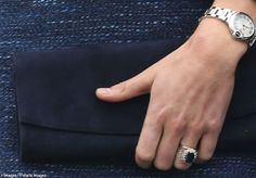 A closer view of Kate's Muse clutch by Stuart Weitzman (¢245, roughly$410) and her Ballon Bleu de Cartier watch ($4550).