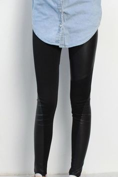 Skinny leggings crafted in polyester cotton, featuring a mid rise waistband, contrast faux leather panel to the main with stitching detail, in a slim fit.