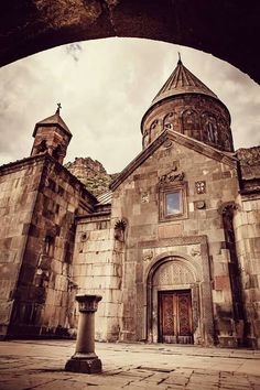 """Geghard (Armenian: Գեղարդ, meaning """"spear"""") is a medieval monastery in the Kotayk province of Armenia, being partially carved out of the adjacent mountain, surrounded by cliffs. It is listed as a UNESCO World Heritage Site. The monastery complex was founded in the 4th century by Gregory the Illuminator at the site of a sacred spring inside a cave. #TheartsofArmenia #Armenia #Monastery https://www.instagram.com/the_arts_of_armenia/"""