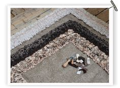 DIY Beautiful RAG RUG! How to picture tutorial  The technique is quite simple, you push the tip of the tool through the hessian  and clip it to one of your strips...Then you pull the strip back through the loop of hessian and centralise it, this process is repeated in lines around your rug. That is all!!!