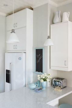Sarah Richardson from HGTV shares her kitchen design recipes, including this clean white kitchen with robin's egg blue accents like a chalkboard frame and teapot. Bakers Kitchen, Quirky Kitchen, Stylish Kitchen, Kitchen Decor, Kitchen Ideas, Kitchen Designs, Kitchen Small, Kitchen White, Sarah Richardson Kitchen