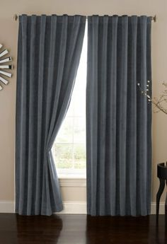 Absolute Zero Velvet Blackout Home Theater Curtain Panel, 84-Inch, Stone Blue by Absolute Zero. $39.95. 100% polyester. Easy care, machine wash, tumble dry low, iron low if needed. Blocks 100-percent of intrusive light. Lush velvet fabric emulates real theater curtains. Offered in hard to find extended lengths up to 95-inch. Reduces unwanted noise and offers thermal benefits. Who says you can't watch movies during the day. Now you can transform any room in your home into t...