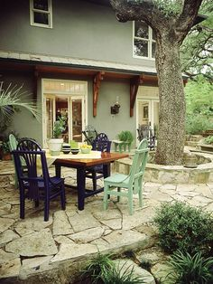 A large tree didn't deter plans for this backyard patio--the homeowners simply designed around it, making it a key element. The low stone wall around the tree doubles as seating. The flagstone floor is set in sand over landscaping fabric that inhibits weeds but lets moisture reach the tree's roots.