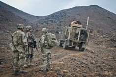 U.S. Army Soldiers with 3rd Platoon, Battery A, 2nd Battalion, 377th Parachute Field Artillery Regiment, Task Force Spartan, prepare to ascend a hillside to an observation post in Afghanistan. U.S. Army photo by Spc. Ken Scar, 7th MPAD.
