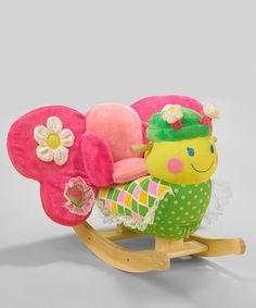 As if a big, cuddly butterfly wasn't enough fun, here's one to ride on. Buttons on the back of Bonita's head play four original songs, while hidden rattles and crinkles throughout add extra delight. With so much to explore, this rocker is the perfect all-in-one playmate.Weight capacity: 80 lbs.Approx. 12'' W x 17'' H x 24'' D