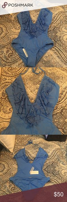 L Space cut out one pice swim suit L Space cut out one pice swim suit, open back, scrunch bottoms. Never worn. New with tags and panty liner. L Space Swim wear  Swim One Pieces
