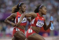 Tianna Madison hands off the baton to Lauryn Williams during their Olympic Women's 4X100m Team Relay Heat. However, Lauryn did not run in the GOLD Medal final.