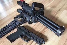 Microgun Empty Shell Defense - World's First Hand Held Electric Gatling Gun pictures 001 Military Weapons, Weapons Guns, Guns And Ammo, Rifles, Fire Powers, Cool Guns, Assault Rifle, Firearms, Shotguns