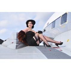 Glamorous woman in 1940s style attire sitting on a vintage aircraft Canvas Art - Christian KiefferStocktrek Images (35 x 23)