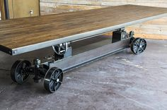 Train conference table with a 12 foot reclaimed boxcar oak top. Designed and built by Vintage Industrial in Phoenix...