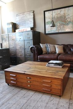Large flat file cabinets as coffee tables.