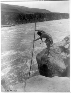 Description of  Title: The fisherman--Wishham (i.e., Wishram).   Date Created/Published: c1910 March 11.   Summary: Tlakluit Indian, standing on rock, fishing with dip net.   Photograph by Edward S. Curtis, Curtis (Edward S.) Collection, Library of Congress Prints and Photographs Division Washington, D.C.