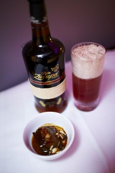 Quetzaltenango Fizz, Ingredients: Ron Zacapa, Lemon Juice, Sugar, Shiraz and Soda.