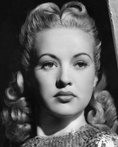 Betty Grable b & w pic, not smiling, curled blonde hair - (1916-1973) pic by 20th C Fox.