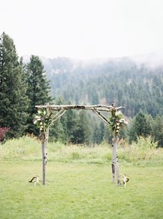 Rebecca Hollis Photography | Bozeman Montana Wedding | rustic antler and floral arbor