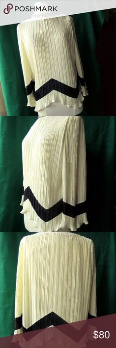 Antique B Altman Handkerchief Hem Accordion Blouse Absolutely elegant, gorgeous antique blouse by B. Altman & Co., 5th Avenue New York, a high-end clothing designer from the 1950s. It's size 12, 100% polyester, accordion pleated in a lovely ivory. Lightly ruffled handkerchief hemline accents the chevron zig-zag trim along the 3/4 sleeves and lower waist in deep black.   A piece of fashion history, it would make a beautiful addition to any ensemble. Pair with a wiggle pencil skirt and some…