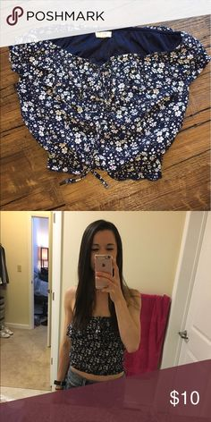 Flower print crop top Navy crop top with white and pink flower print, bow at top, and ruched bottom. Size medium Tops Crop Tops