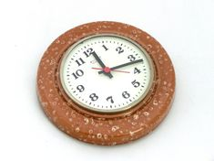 Vintage ceramic clock was made in GDR East Germany 70s. It is in very good vintage conditionand has very nice brown color. It hasnt any scratches. Clock has open glass circle. It needs only one R6 1.5V battery to operate. Clock will be a wonderful addition to display in any kitchen and