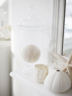 Summer Decor: Seaside Accents  A white-on-white collection of beach finds adds character to a mantel.