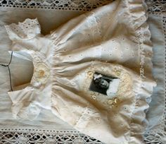 how cute would this be with one of mother's old baby dresses and an old picture of her ... too, too, too!